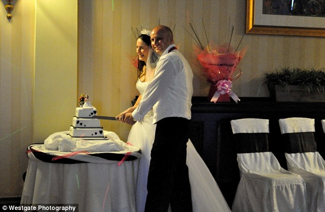 Original set: An awkward side shot of the couple cutting their wedding cake - the photo