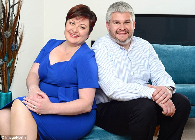 Content with a kiss and cuddle on the sofa: The couple, who have a four-year-old, say they are happy not to take it further