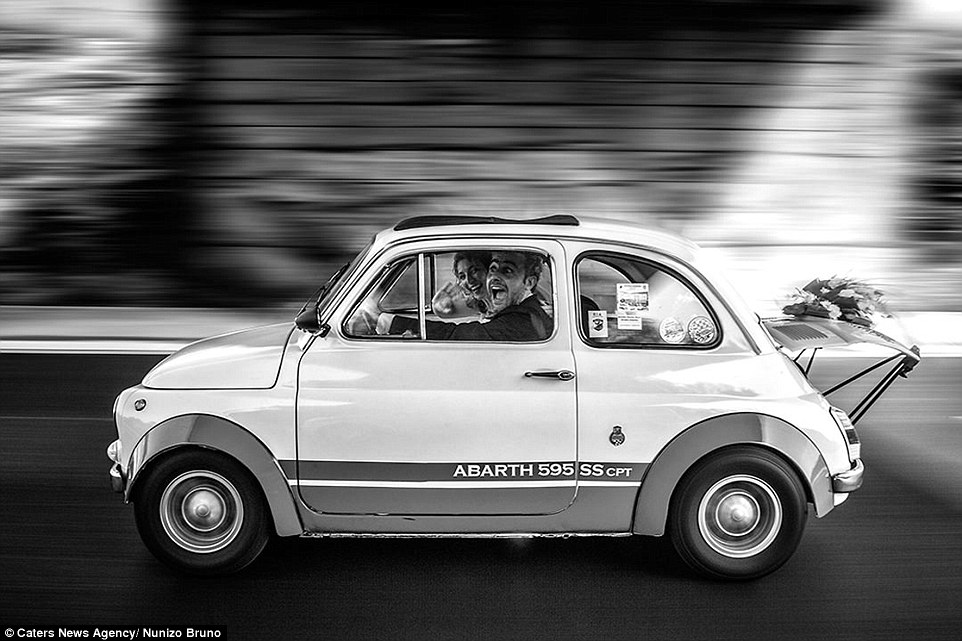A fun loving couple are snapped by Nunizo Bruno as they ride a mini  in Italy