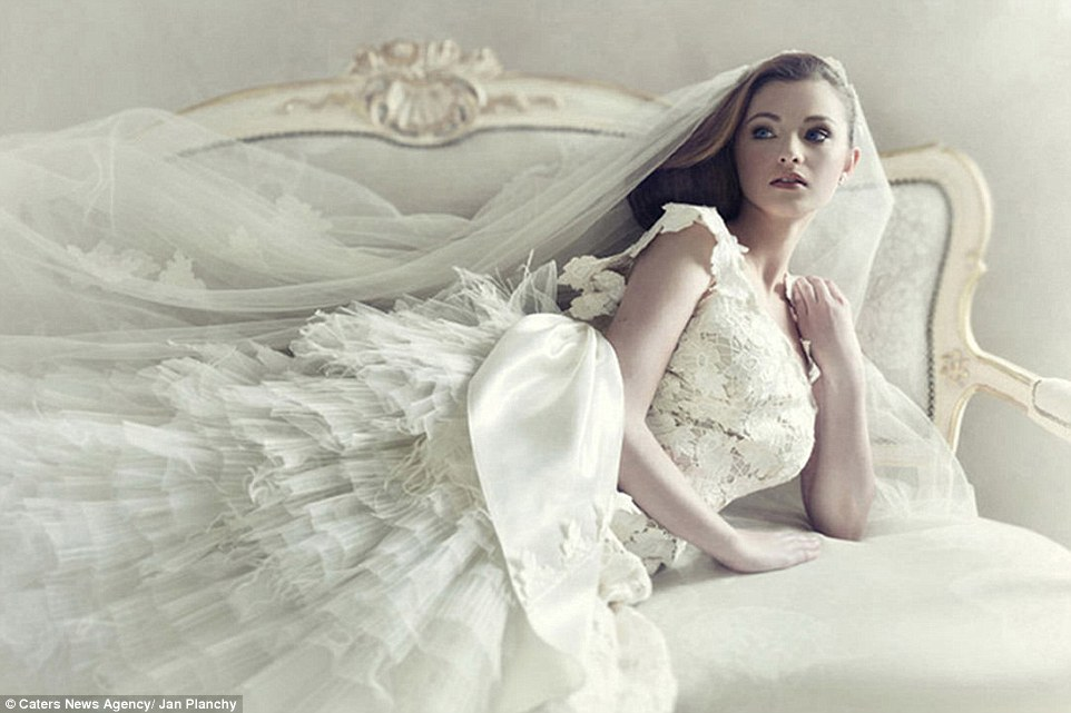 An elegant bride poses on a chaise long in this luxurious snap captured by Jan Planchy in Vienna Austria