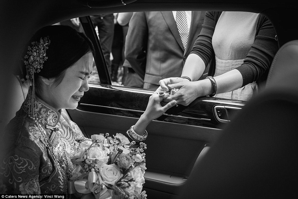 Vinci Wang captures this emotional bride as she prepares to enter her ceremony in Fuzhou China